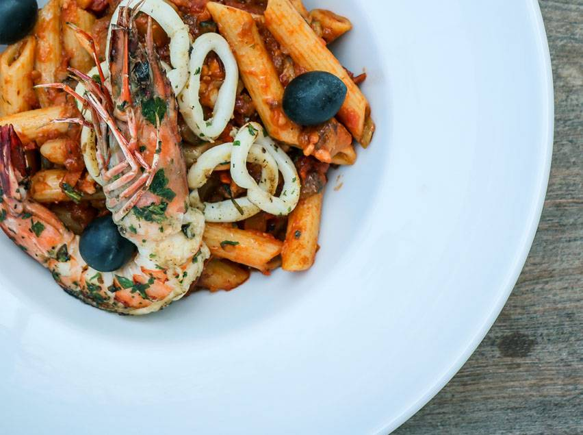 Seafood in red sauce pasta